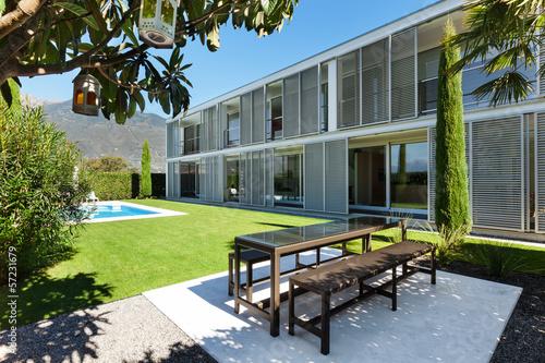 Fototapeta Modern house with pool, view from the garden obraz na płótnie