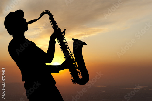 Saxophonist at sunset Poster