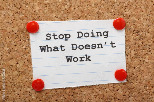 Stop Doing What Doesn't work on a cork notice board Wallpaper Mural