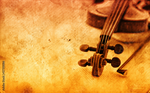 Classic violin on grunge paper background