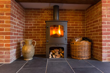 Wood Burning Stove In Brick Fi...