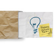 thinking outside the box on sticky note and lightbulb as creativ