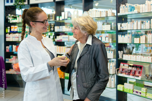 Keuken foto achterwand Apotheek Pharmacist and grateful senior woman.
