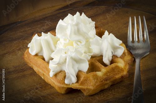 freshly baked waffles with milk cream close up on the wood #57393093