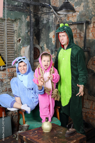 Türaufkleber Phantasie Father, mother and little daughter in costumes of dragons