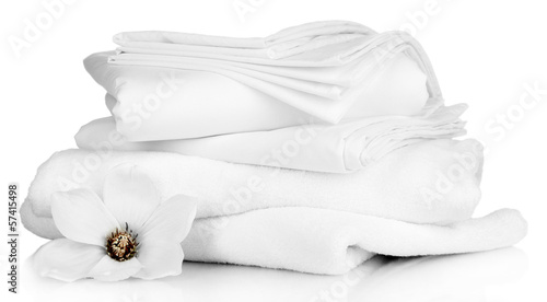 Valokuva  Stack of clean bedding sheets and towels isolated on white