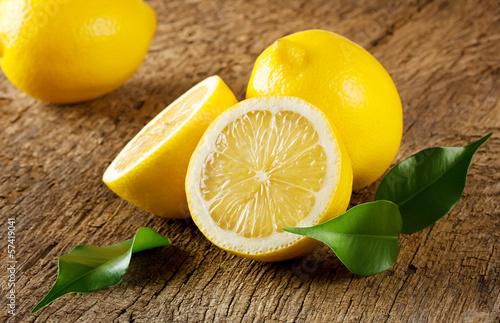 Ripe yellow lemons with leaves Wallpaper Mural