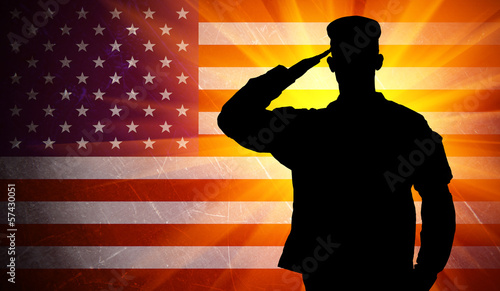 Fotografiet Proud saluting male army soldier on american flag background