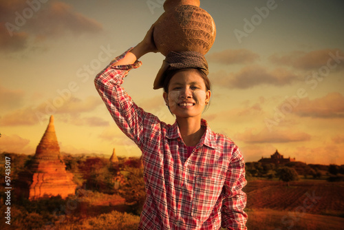 happy asian traditional farmer harvest at myanmar, bagan carryin Canvas Print