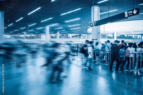 passengers motion blur in subway station