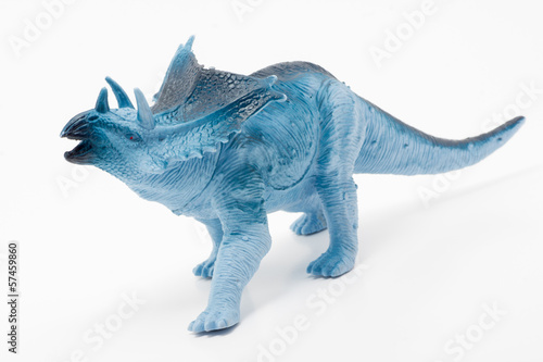Blue toy dinosaur on a white background.