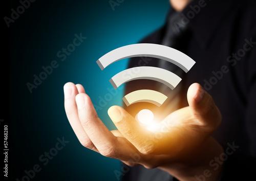 Fotografía  Símbolo tecnología wifi empresario en la mano