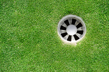 Golf Ball Into The Hole