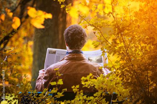 Fototapeta Man reading Newspaper obraz na płótnie