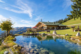 Fototapeta Landscape - Mountain chalet with swimming pond