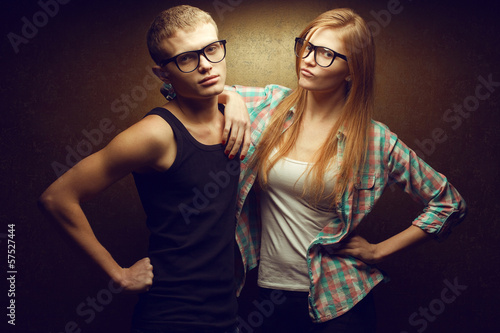 Photo  Portrait of gorgeous red-haired (ginger) fashion twins in casual