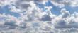 Leinwandbild Motiv Blue sky with gray clouds