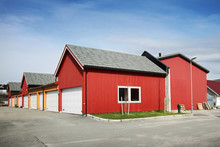 Traditional Rural Red And Yellow Wooden Norwegian Garages