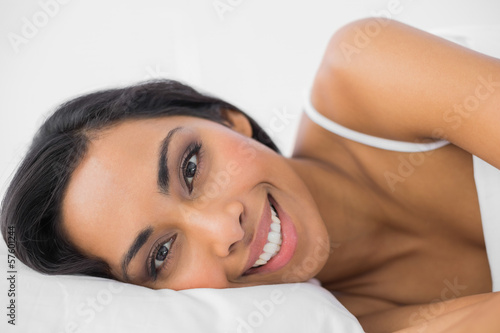 Wall Murals Equestrian Gorgeous calm woman lying under the cover on her bed