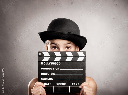 Fotografia, Obraz  little girl holding a movie clapper board