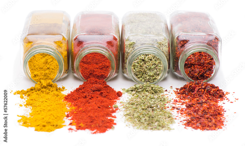 Fototapety, obrazy: Different spices spilling from spice jars isolated on white