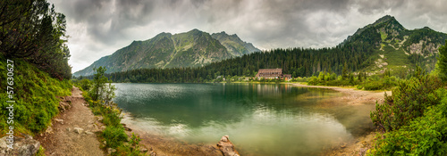 Tuinposter Bleke violet mountain landscape with mountain chalet