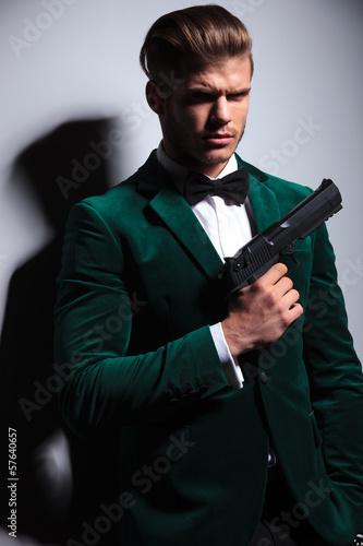 фотография  young man James Bond asassin type