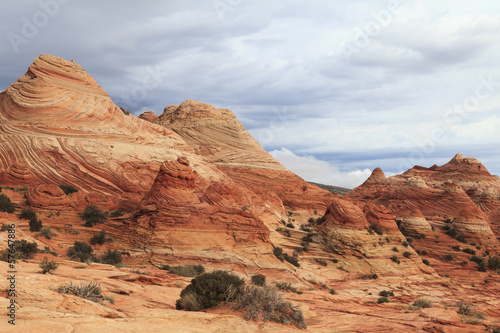Tuinposter Red sand dunes and rock desert