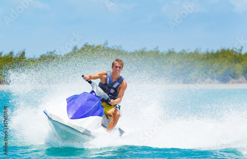 Tuinposter Water Motor sporten Man on Jet Ski