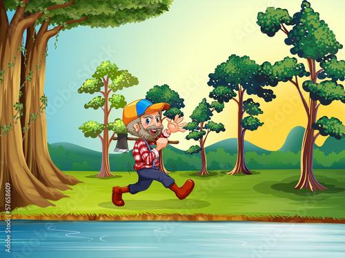 Aluminium Prints River, lake A happy woodman walking at the riverbank