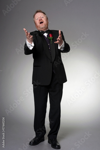Fotografie, Obraz  Middle aged opera singer performing
