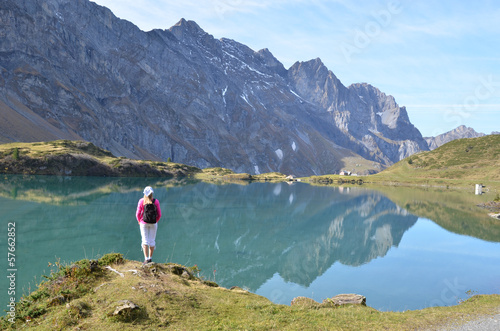 Poster Printemps Girl enjoying Alpine panorama. Switzerland