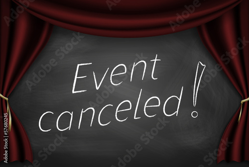"Fotografía  Caption ""event canceled"" on the board with stage curtains"