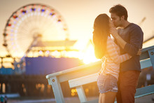 Romantic Couple Kissing In Front Of Santa Monica