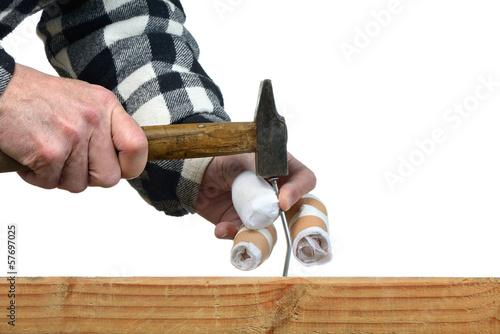 a handyman awkward trying to hammer a nail Canvas Print
