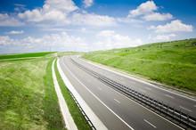 Highway On A Sunny  Landscape