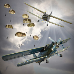 FototapetaRetro style picture of the biplanes with airborne infantry.