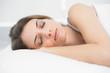 Peaceful sleeping woman lying on her bed