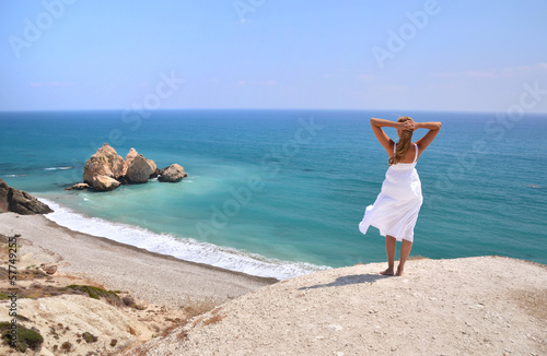 Fotobehang Cyprus Girl looking to the sea near Aphrodite birthplace, Cyprus