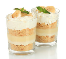 Delicious Dessert With Banana And Caramel Isolated On White