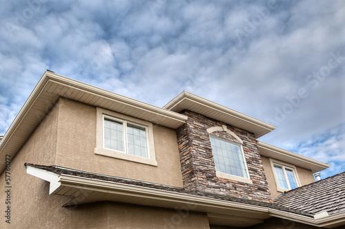 Fotografia, Obraz Roofline showing gutter, soffit, windows, roof and stones