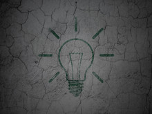 Finance Concept: Light Bulb On Grunge Wall Background