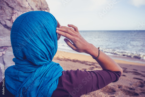 Obraz na plátně  Rear view of woman with headscarf looking at the sea