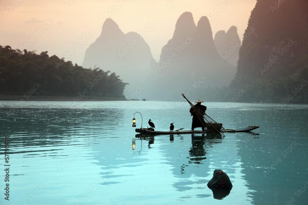 Fototapeta Chinese man fishing with cormorants birds