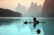 Leinwanddruck Bild - Chinese man fishing with cormorants birds