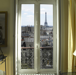 Fototapeta France - Paris - Window with Eiffel tower and roofs view