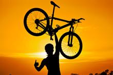 Cyclist Raising His Bike With ...
