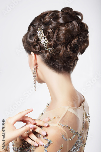 Photo  Refinement. Sophistication. Stylish Woman with Festive Coiffure