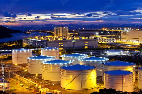 Fényképezés  Oil tank at sunset in Hong Kong
