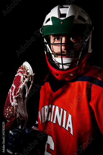 Fotografiet  Lacrosse player, studio shoot on the black background